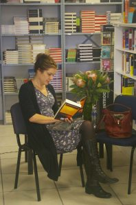 Emma after the launch, reading Siri Hustvedt's The Blazing World